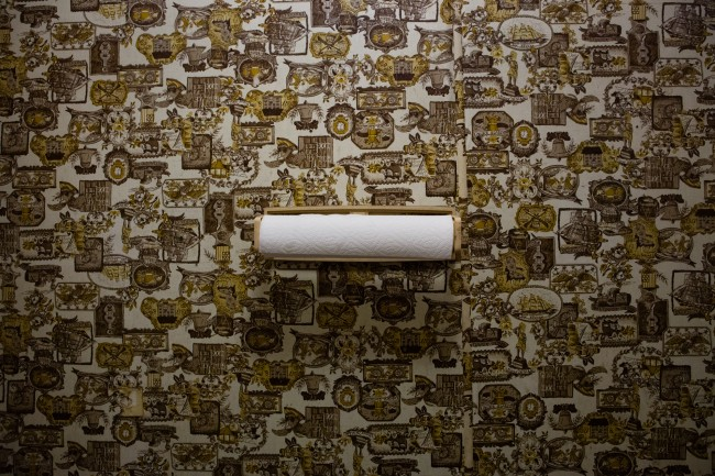 A roll of paper towels sits on the wall in a bathroom in Texas.