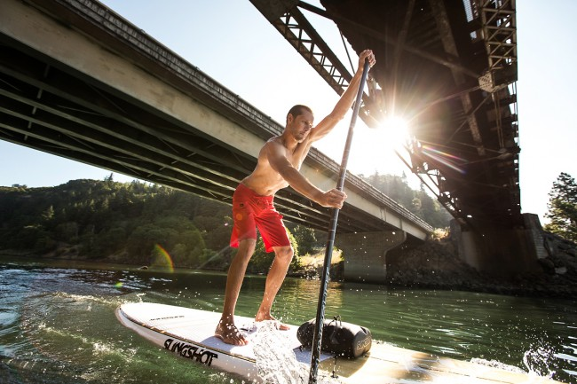 Stand Up Paddle-boarder shot for Slingshot SUP. I am a fan of the underside of bridges. So many people never take the time to explore what lies under them. Each bridge is an opportunity for adventure.