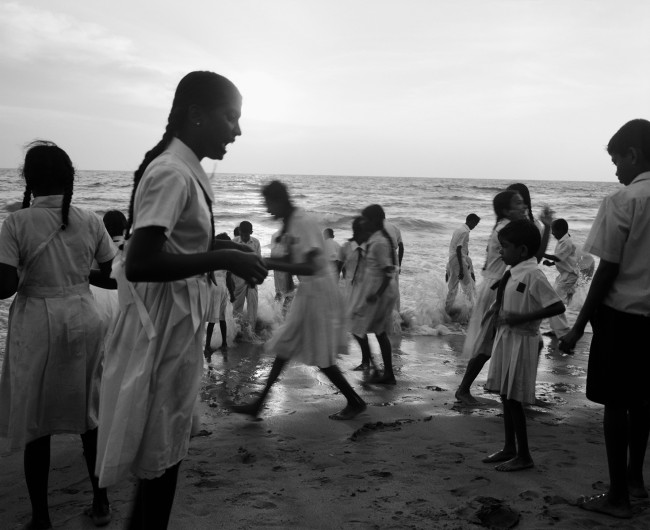 School children playing along the Indian Ocean in Colombo, Sri Lanka. Commissioned by Travel and Leisure Magazine.