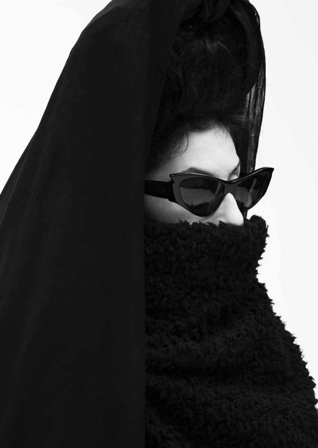 This image of Diane Pernet was taking in Paris. She is one of that last  true eccentric fashion icons and working with people like her make portraiture such an incredible experience. I love that you can almost see her eyes, but cant quite see where she is looking.