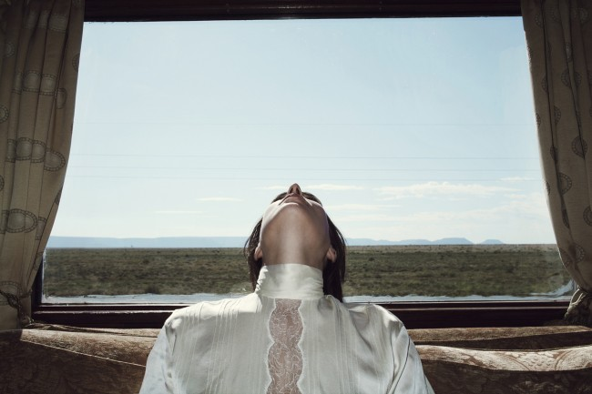 This image was featured on Nowness and was taken on the pan African Rovos rail. I love the starkness of the Karoo as it glides by behind her, and how she bisects it in quite a violent way. I find this image quite jarring in the end, even though at first glance its so peaceful