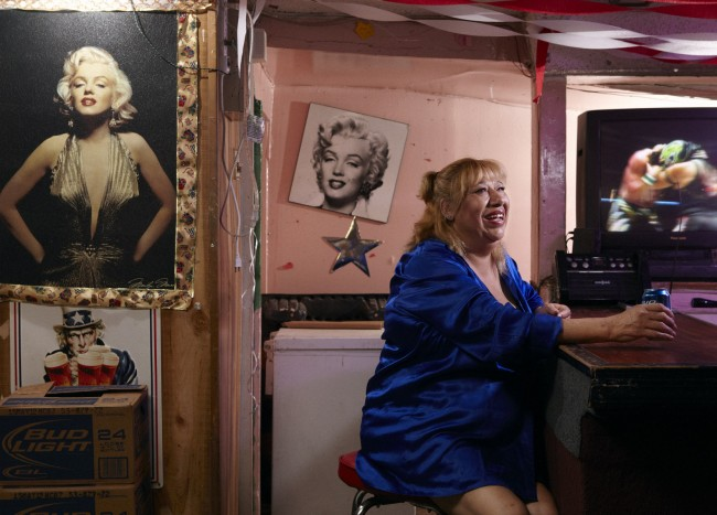 """Goldie"" crossed the border when she was 16 and started dancing at a topless bar where most of the dancers were illegal immigrants from Juarez. She soon left that life behind, and now she owns Goldie's Bar, a tiny cantina in an industrial section of south central El Paso. The walls of Goldie's Bar are littered with pictures of her hero, Marilyn Monroe: ""I like that she often said that women should be liberated, that men shouldn't limit them, that a woman should be the way she wants to be."""