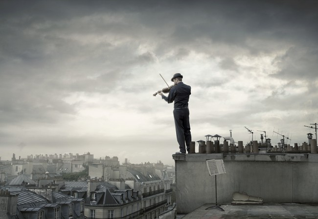 """Fiddler Over Paris"", a lone fiddler bares his soul to the denizens of the 7th arrondissement. Shot for an int'l travel company."