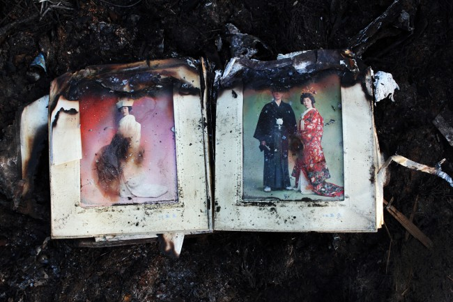 Nearly burned out wedding album remained at a tsunami destroyed and burned down area in Kesennuma, Miyagi, where many people inside the cars and ships were washed out and trapped and killed due to the tsunami. And survivors could hear the crying all the night. Japan, 2011.