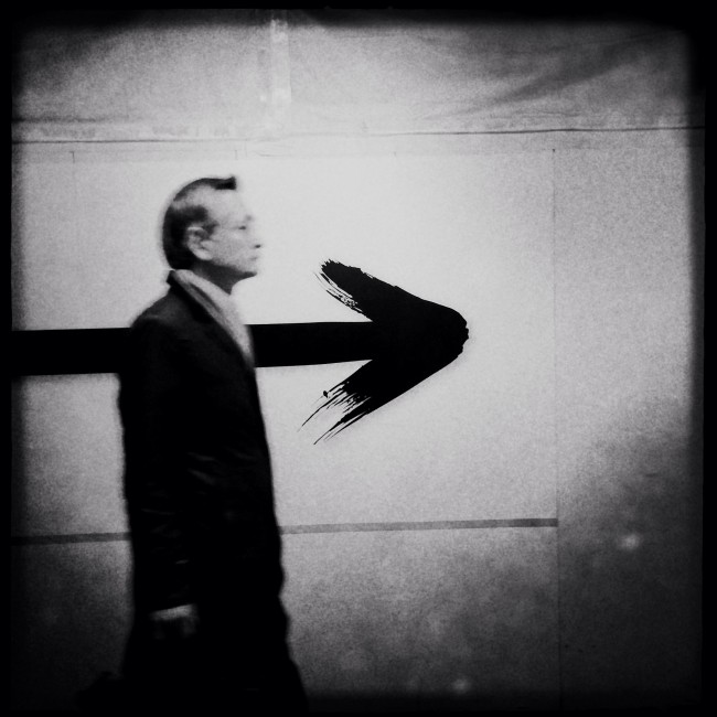 Self-Metaphors series: A businessman with an arrow head, in Marunouchi, Tokyo, Japan, 2013.