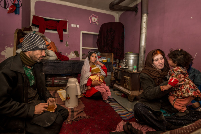 Zarghoma, her son, daughter-in-law and their children having tea several days before their  home was ruined.
