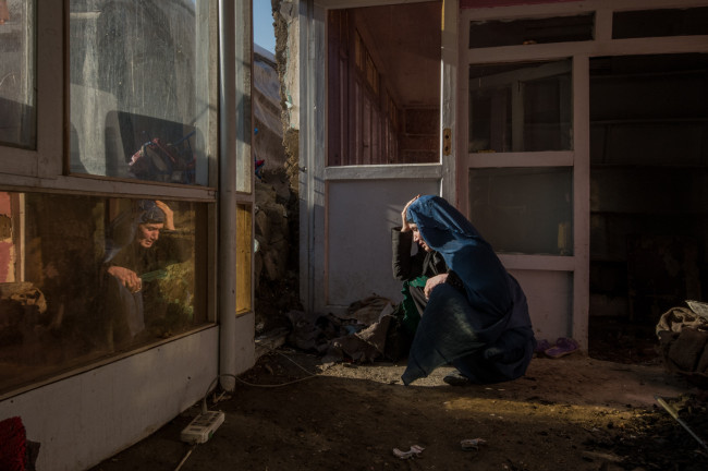 Kabul, Afghanistan. Zarghona is visiting her home for the first time since the roof had fallen during a heavy snow storm.