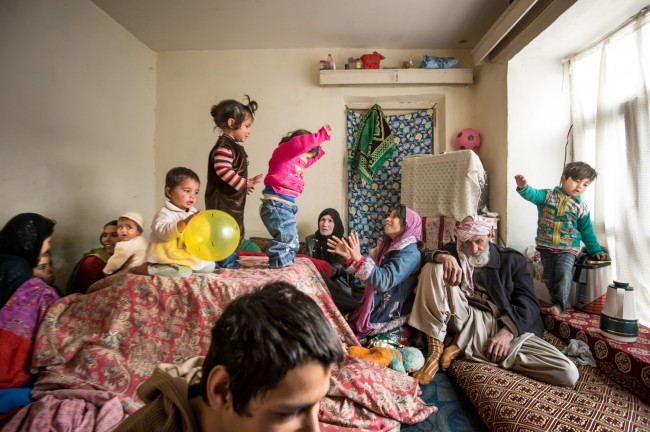 Kabul, Afghanistan.  A child bride at ten, Zarghona, now fifty, has a large extended family.