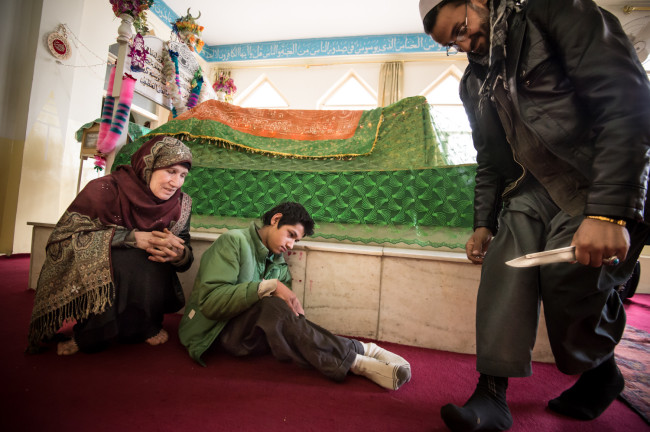 "Zarghona took her son Barialy to a shrine in Kabul. Barialy was injured in The Civil War. There the ritual of ""Doing Dam"" was performed; verses are read from the Holy Koran and the touching with a knife to a sick or injured person is to take away the injury or illness."