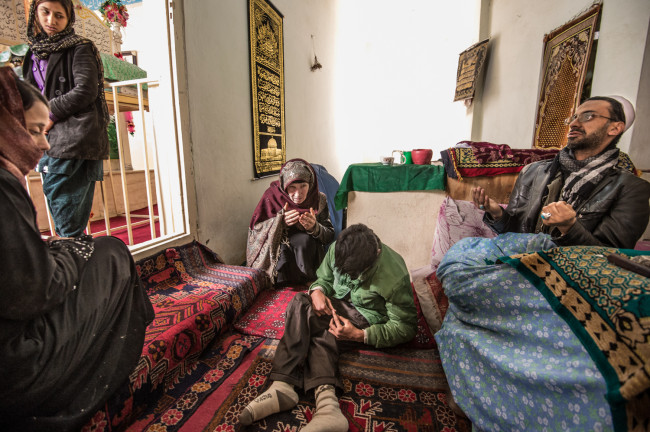 Kabul, Afghanistan. Zarghona and family go to the shrine to be healed and to pray.