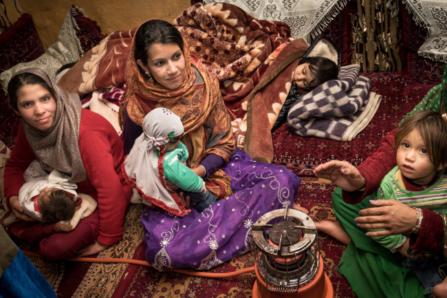 Camilla, one of Zarghona's daughter-in-laws, Gulali, Malai, daughters and their children are together for a family gathering on Friday afternoon.