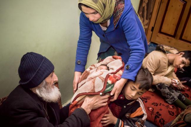 Gh ullam Farooq, Zarghona's 93 year old husband, still loves caring for the children.