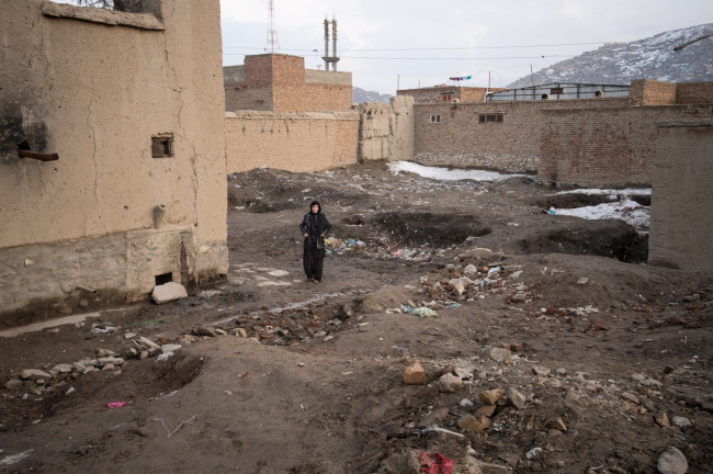 Zarghona visiting the location of where her home had collapsed. She found out that night that her husband and son had sold the property and had not told her. Now, with an aging husband of ninety-two, an invalid son, one young daughter,  and several grandchildren to support, she has no property and has become severely depressed.