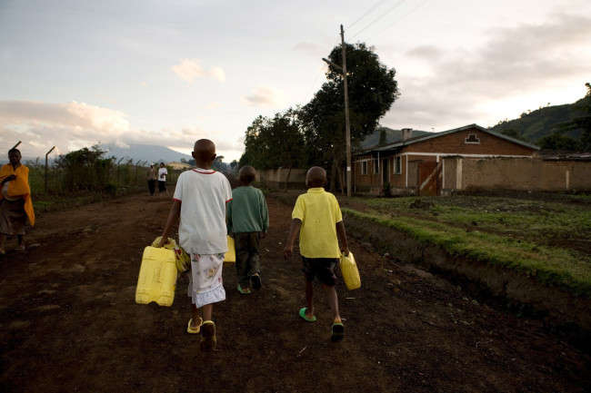 Masengesho walks to get water at dawn. Gisenyi, Rwands
