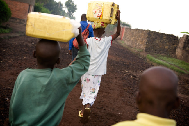 Masengesho's least favorite chore is carrying water back home. Understandably,  as the jug weighs around 44 pounds.