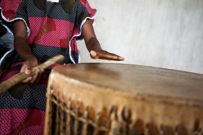 Masengesho playing drums and singing along with the fellow members of her church's children's choir.