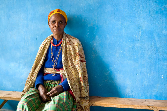 Wearing a typical Rwandan mish mash of patterns, this stately lady waits at a clinic in Gisenyi, Rwanda.