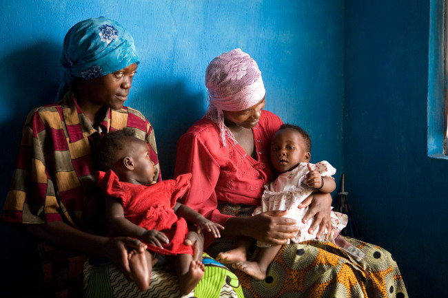 Mothers wait with the babies at a clinic in Gisenyi, Rwanda.